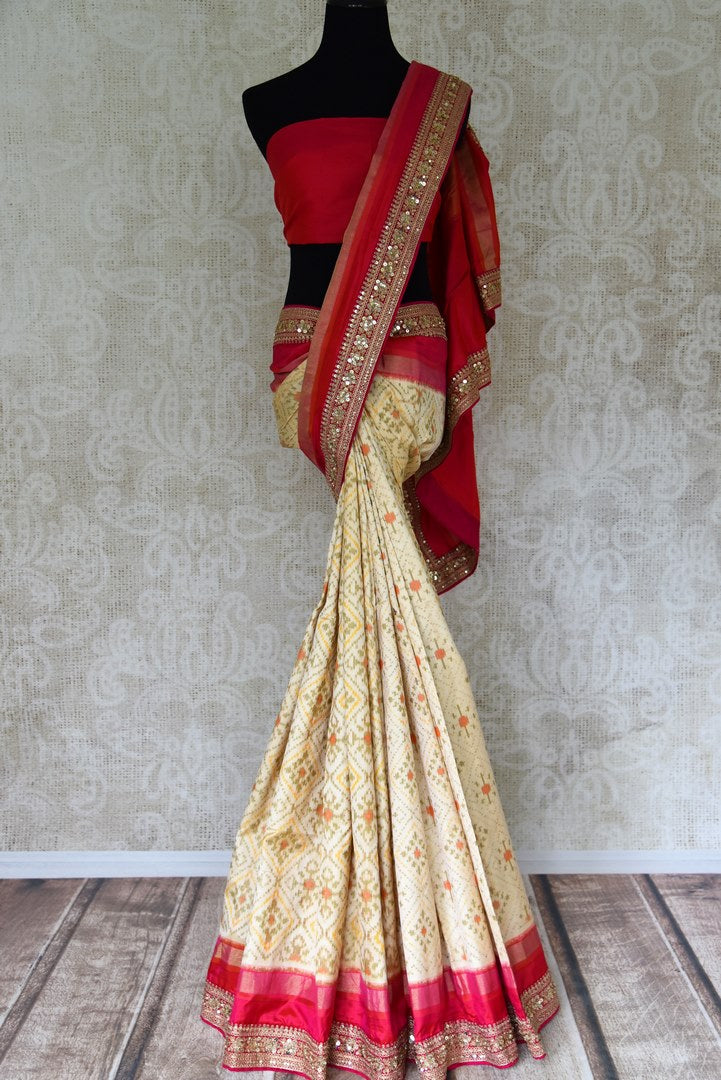 Buy cream ikkat silk saree with pink embroidered border online in USA. Shop stunning silk sarees in USA from Pure Elegance online store. Explore a world of traditional Indian sarees, wedding sarees, embroidered saris and much more at our exclusive Indian clothing store in USA.-full view