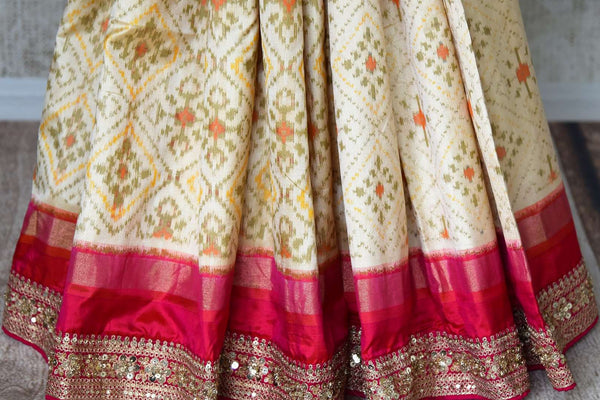 Buy cream ikkat silk saree with pink embroidered border online in USA. Shop stunning silk sarees in USA from Pure Elegance online store. Explore a world of traditional Indian sarees, wedding sarees, embroidered saris and much more at our exclusive Indian clothing store in USA.-pleats