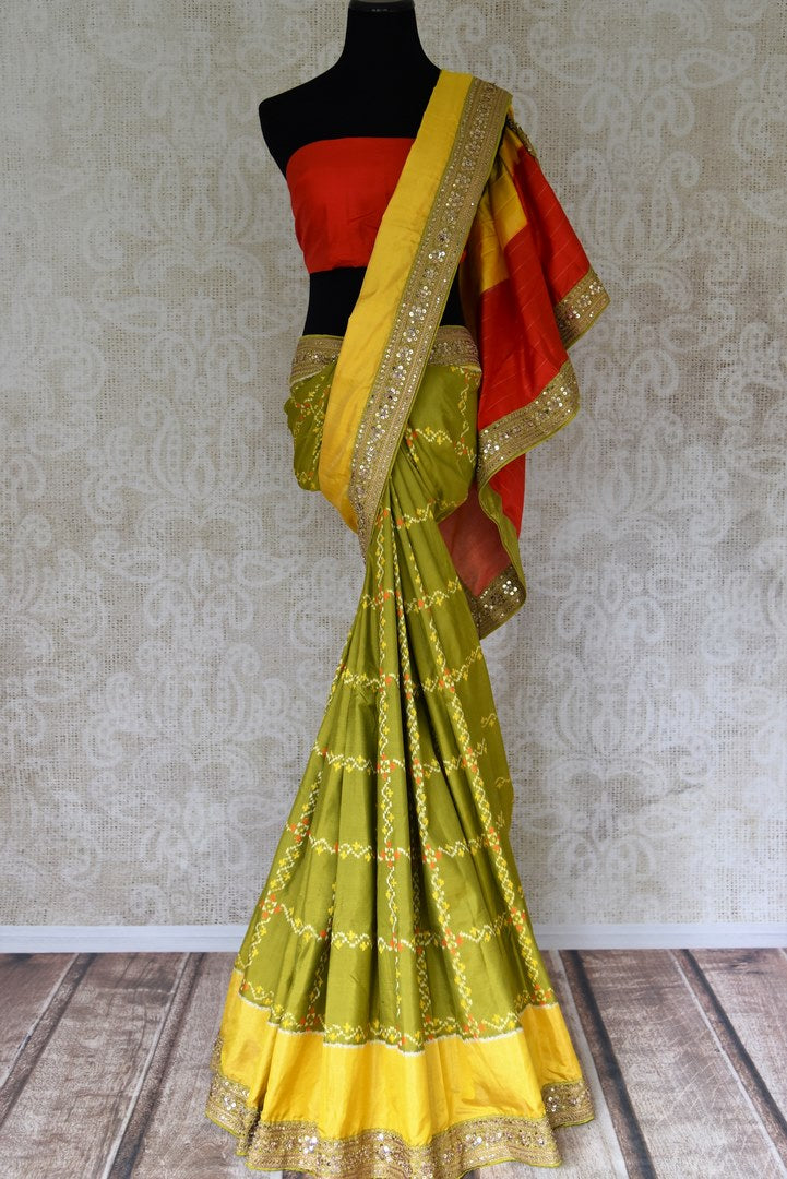 Shop green ikat silk saree with yellow embroidered border online in USA. Shop stunning silk sarees in USA from Pure Elegance online store. Explore a world of traditional Indian sarees, wedding sarees, embroidered saris and much more at our exclusive Indian clothing store in USA.-full view
