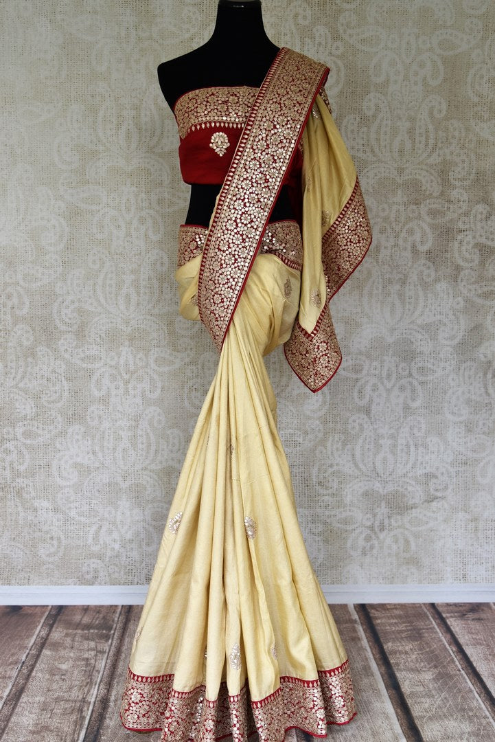 Shop cream tissue georgette tussar sari with gota patti embroidery online in USA from Pure Elegance. Be an epitome of Indian fashion on special occasions with beautiful designer sarees, Banarasi sarees, Kanchipuram silk saris available at our Indian fashion store in USA. -full view
