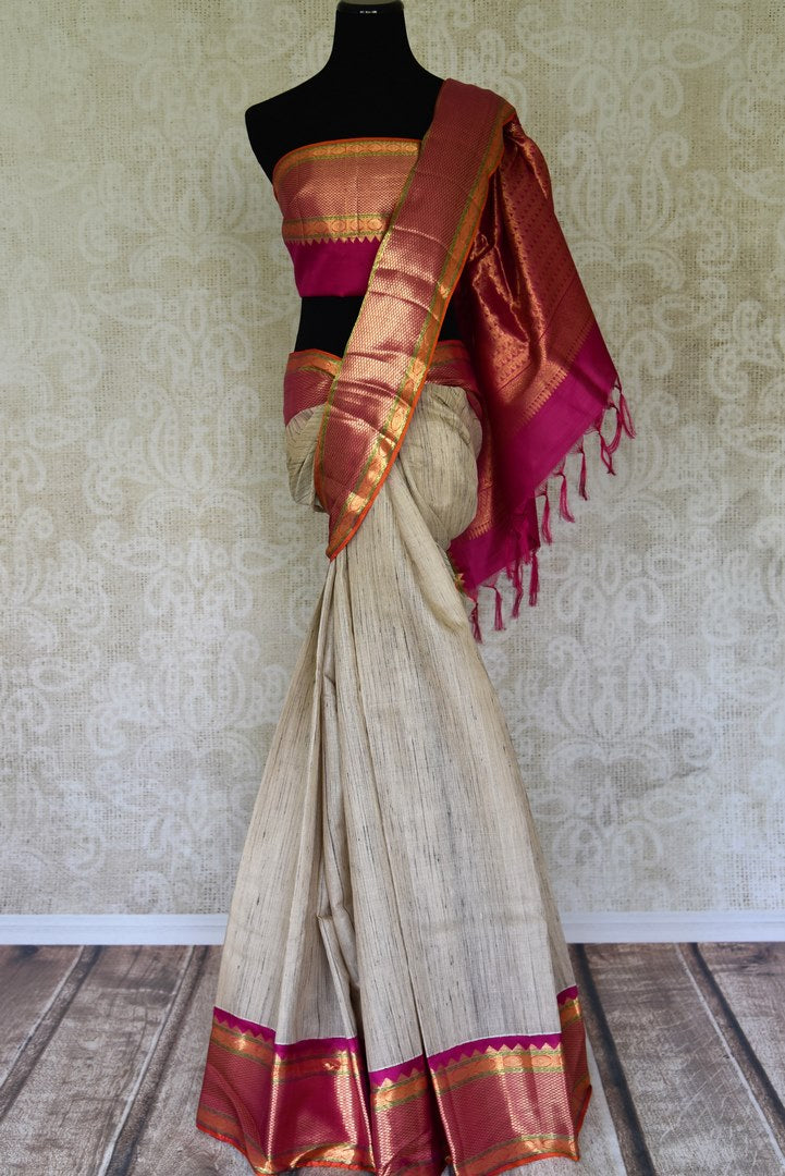Buy off-white Kanjivaram sari with multicolor zari border online in USA from Pure Elegance. Be an epitome of Indian fashion on special occasions with beautiful designer sarees, Banarasi sarees, Kanchipuram silk sarees available at our Indian fashion store in USA. -full view