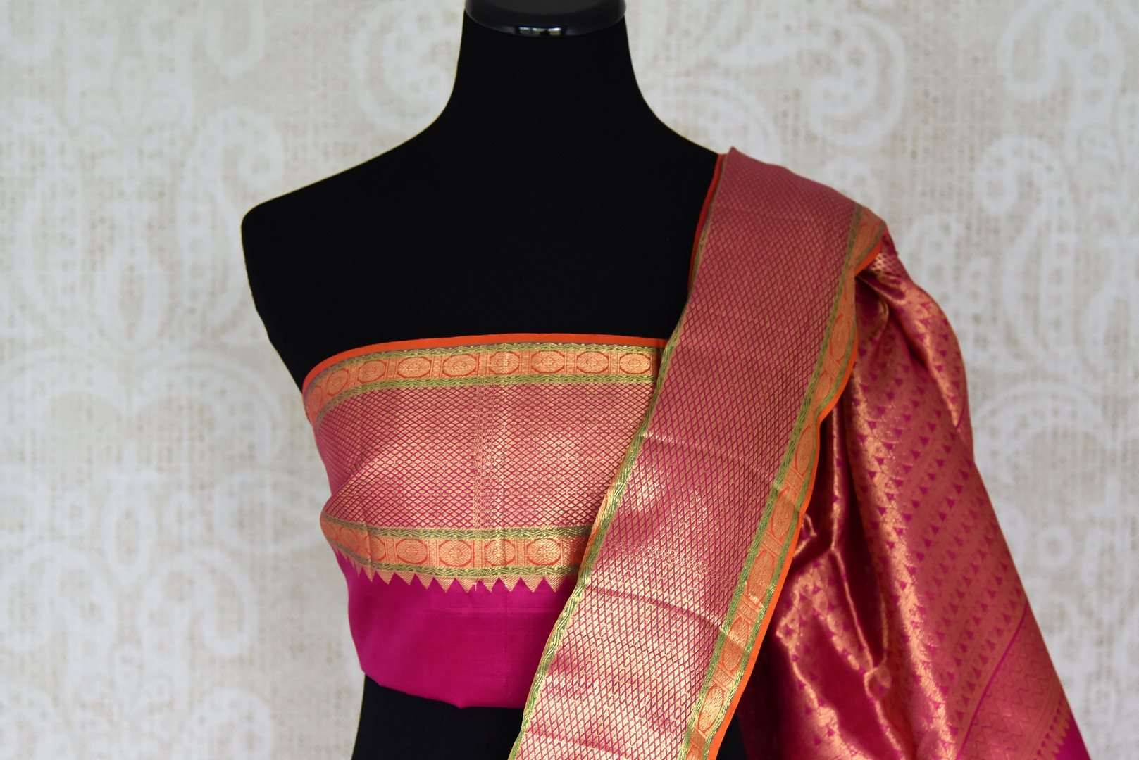 Buy off-white Kanjivaram sari with multicolor zari border online in USA from Pure Elegance. Be an epitome of Indian fashion on special occasions with beautiful designer sarees, Banarasi sarees, Kanchipuram silk sarees available at our Indian fashion store in USA. -blouse pallu