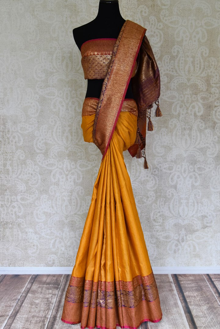 Shop beautiful mustard color tussar Benarasi saree online in USA with antique zari border. Be the talk of every occasion in beautiful Indian designer saris, pure silk sarees, Banarasi sarees from Pure Elegance clothing fashion store in USA this wedding season.-full view