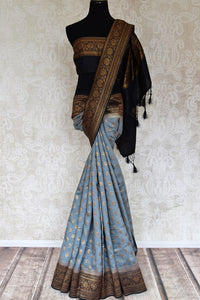 Shop grey muga tussar saree online in USA with zari buta and black zari border from Pure Elegance. Choose from a range of exquisite Indian designer saris, Banarasi sarees, pure silk sarees in beautiful styles and designs from our Indian fashion store in USA and flaunt your tasteful sartorial choices on special occasions.-full view