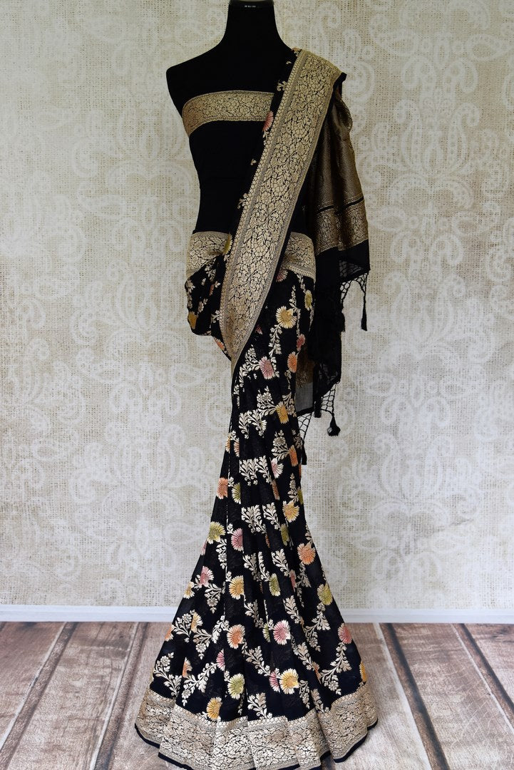 Shop black georgette Banarasi saree online in USA with floral zari work. Find a splendid collection of Indian designer sarees with blouses in USA at Pure Elegance Indian clothing store. Make a striking appearance on festive occasions by shopping from a range of pure silk saris, Banarasi sarees, embroidered saris from our online store.-full view