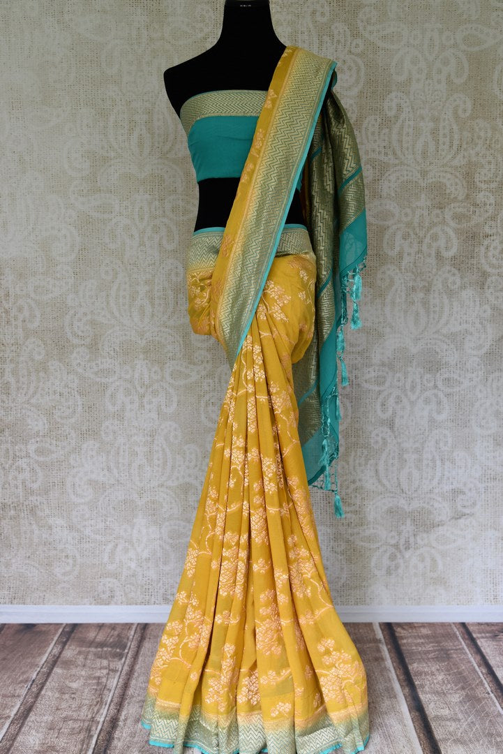 Buy yellow Banarasi georgette saree online in USA with blue zari border. Find a splendid collection of Indian designer sarees with blouses in USA at Pure Elegance Indian clothing store. Make a striking appearance on festive occasions by shopping from a range of pure silk saris, Banarasi sarees, embroidered saris from our online store.-full view