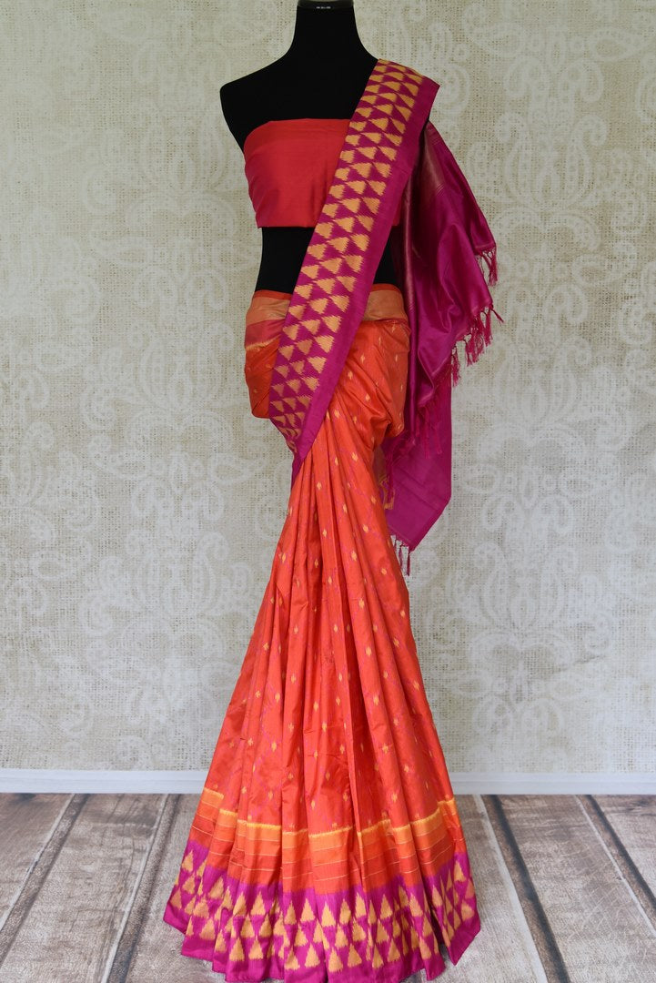 Shop traditional red ikkat silk sari online in USA with pink ikat border. Find a splendid collection of Indian designer sarees with blouses in USA at Pure Elegance Indian clothing store. Make a striking appearance on festive occasions by shopping from a range of pure silk saris, Banarasi sarees, embroidered saris from our online store.-full view