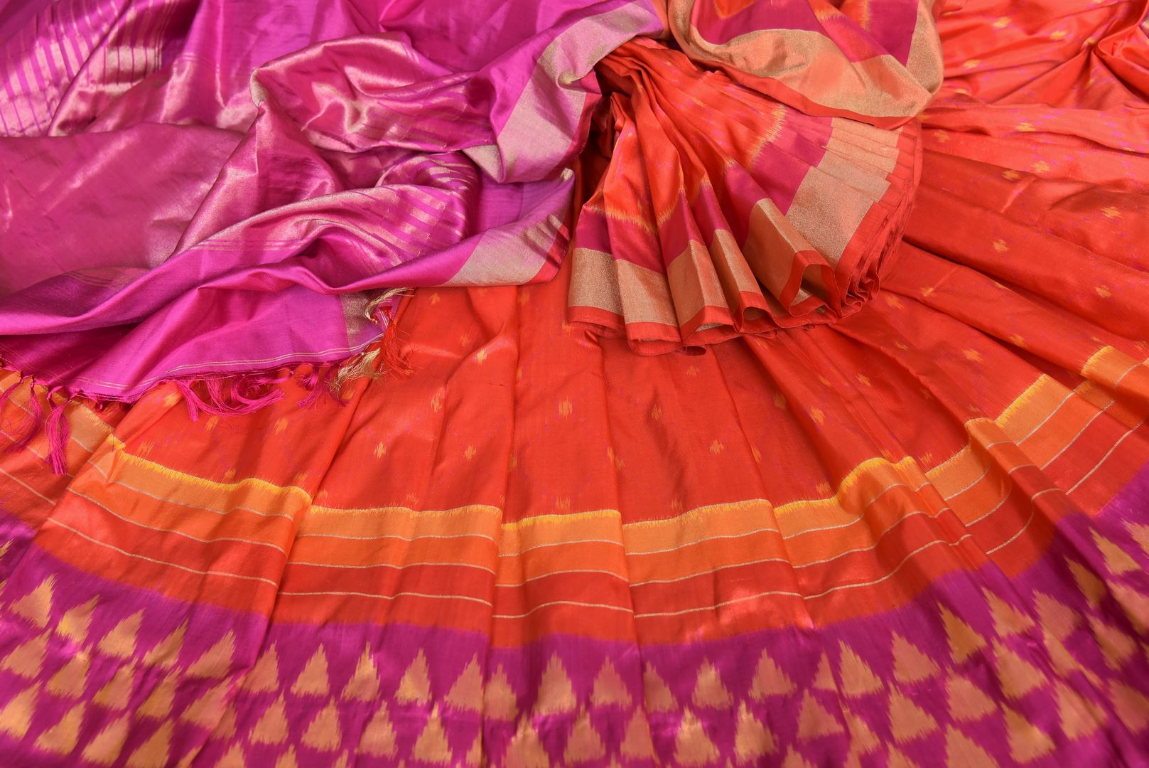 Shop traditional red ikkat silk sari online in USA with pink ikat border. Find a splendid collection of Indian designer sarees with blouses in USA at Pure Elegance Indian clothing store. Make a striking appearance on festive occasions by shopping from a range of pure silk saris, Banarasi sarees, embroidered saris from our online store.-details