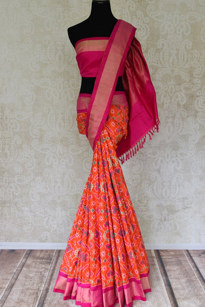 Shop orange ikkat silk sari with zari border online in USA from Pure Elegance. Be occasion ready always with a range of beautiful designer saris, pure silk sarees, handloom saris, Kanchipuram sarees available at our Indian fashion store in USA. Grab your favorite pieces now also available at our online store.-full view