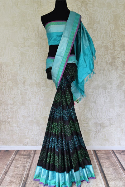 Shop elegant black ikat silk sari with blue zari border online in USA from Pure Elegance. Be occasion ready always with a range of beautiful designer saris, pure silk sarees, handloom saris, Kanchipuram sarees available at our Indian fashion store in USA. Grab your favorite pieces now also available at our online store.-full view
