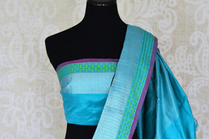 Shop elegant black ikat silk sari with blue zari border online in USA from Pure Elegance. Be occasion ready always with a range of beautiful designer saris, pure silk sarees, handloom saris, Kanchipuram sarees available at our Indian fashion store in USA. Grab your favorite pieces now also available at our online store.-blouse pallu