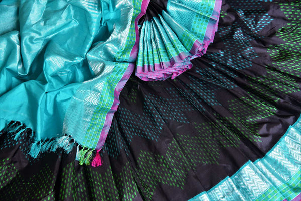 Shop elegant black ikat silk sari with blue zari border online in USA from Pure Elegance. Be occasion ready always with a range of beautiful designer saris, pure silk sarees, handloom saris, Kanchipuram sarees available at our Indian fashion store in USA. Grab your favorite pieces now also available at our online store.-details