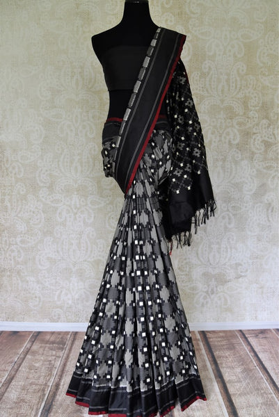 Shop elegant black color ikat silk sari online in USA. Find a splendid collection of Indian designer sarees with blouses in USA at Pure Elegance Indian clothing store. Make a striking appearance on festive occasions by shopping from a range of pure silk saris, Banarasi sarees, embroidered saris from our online store.-full view