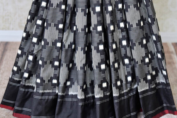 Shop elegant black color ikat silk sari online in USA. Find a splendid collection of Indian designer sarees with blouses in USA at Pure Elegance Indian clothing store. Make a striking appearance on festive occasions by shopping from a range of pure silk saris, Banarasi sarees, embroidered saris from our online store.-pleats