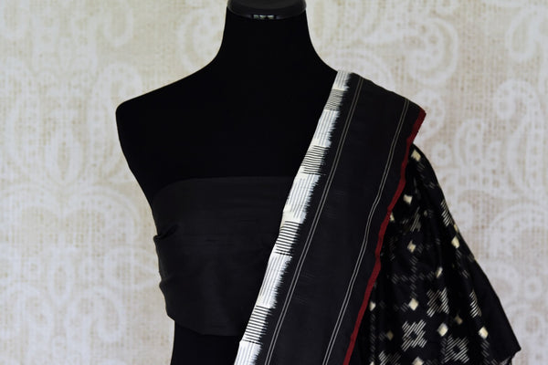 Buy white double ikat silk sari online in USA with black border. Find a splendid collection of Indian designer sarees with blouses in USA at Pure Elegance Indian clothing store. Make a striking appearance on festive occasions by shopping from a range of pure silk saris, Banarasi sarees, embroidered saris from our online store.-blouse pallu