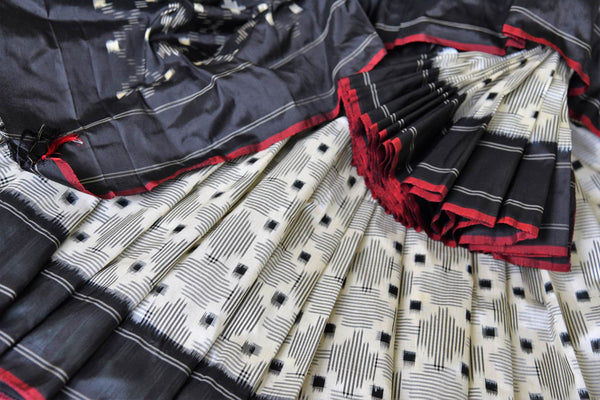 Buy white double ikat silk sari online in USA with black border. Find a splendid collection of Indian designer sarees with blouses in USA at Pure Elegance Indian clothing store. Make a striking appearance on festive occasions by shopping from a range of pure silk saris, Banarasi sarees, embroidered saris from our online store.-details