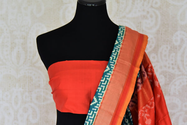 Buy green double ikat silk saree online in USA with red border. Find a splendid collection of Indian designer sarees with blouses in USA at Pure Elegance Indian clothing store. Make a striking appearance on festive occasions by shopping from a range of pure silk saris, Banarasi sarees, embroidered saris from our online store.-blouse pallu