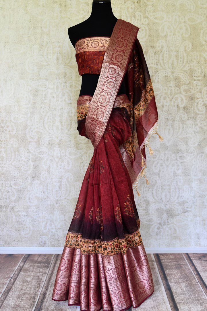 Shop maroon printed linen sari with zari border online in USA from Pure Elegance. Be occasion ready always with a range of beautiful traditional handwoven sarees, pure silk sarees, Banarasi saris, Kanchipuram sarees available at our Indian fashion store in USA. Grab your favorite pieces now also available at our online store.-full view