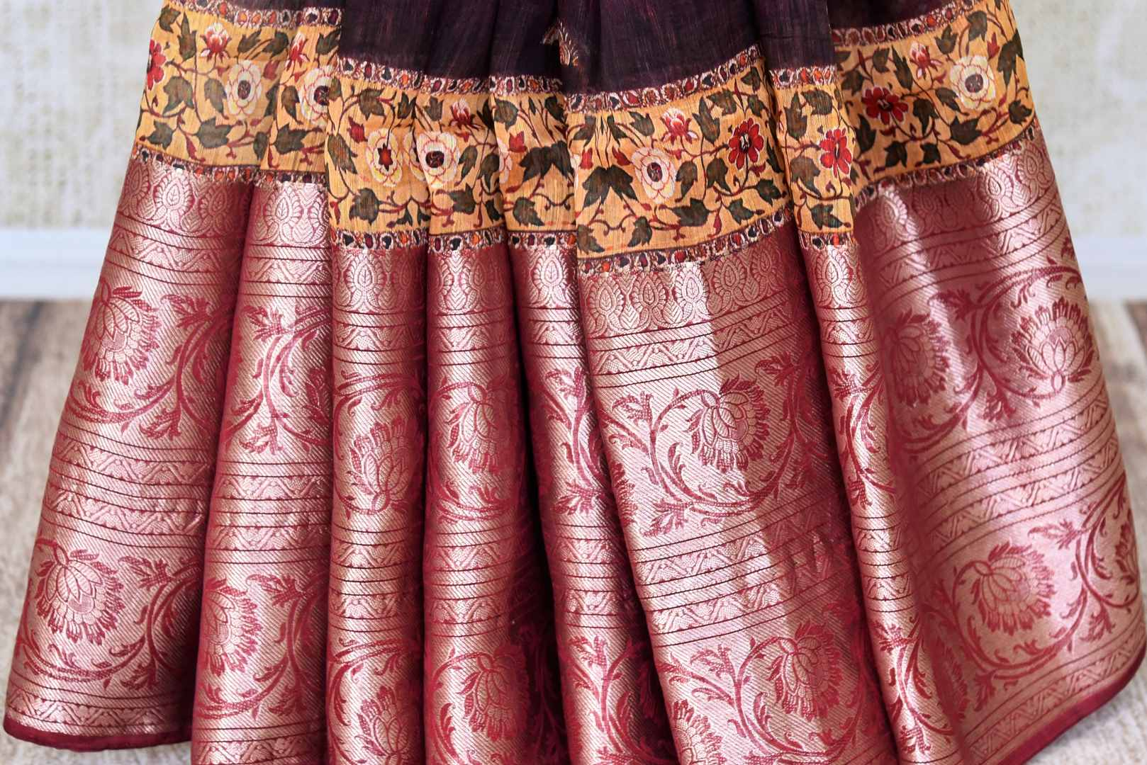 Shop maroon printed linen sari with zari border online in USA from Pure Elegance. Be occasion ready always with a range of beautiful traditional handwoven sarees, pure silk sarees, Banarasi saris, Kanchipuram sarees available at our Indian fashion store in USA. Grab your favorite pieces now also available at our online store.-pleats