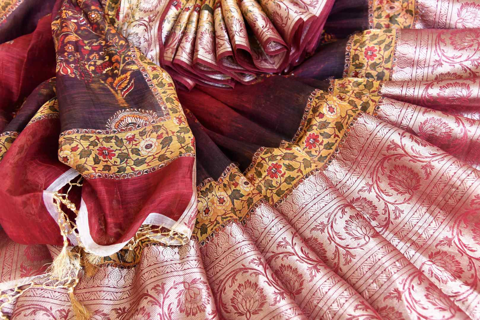 Shop maroon printed linen sari with zari border online in USA from Pure Elegance. Be occasion ready always with a range of beautiful traditional handwoven sarees, pure silk sarees, Banarasi saris, Kanchipuram sarees available at our Indian fashion store in USA. Grab your favorite pieces now also available at our online store.-details