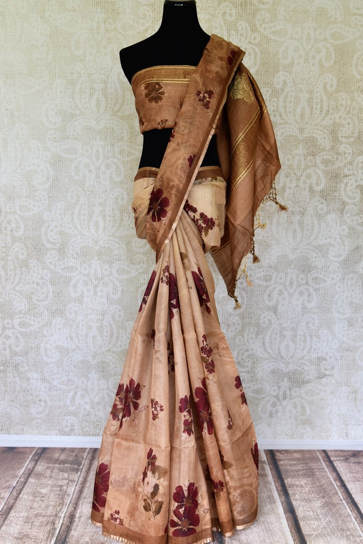 Buy beige tussar Benarasi sari with floral print online in USA from Pure Elegance. Be occasion ready always with a range of beautiful traditional handwoven saris, pure silk sarees, Banarasi saris, Kanchipuram sarees available at our Indian fashion store in USA. Grab your favorite pieces now also available at our online store.-full view