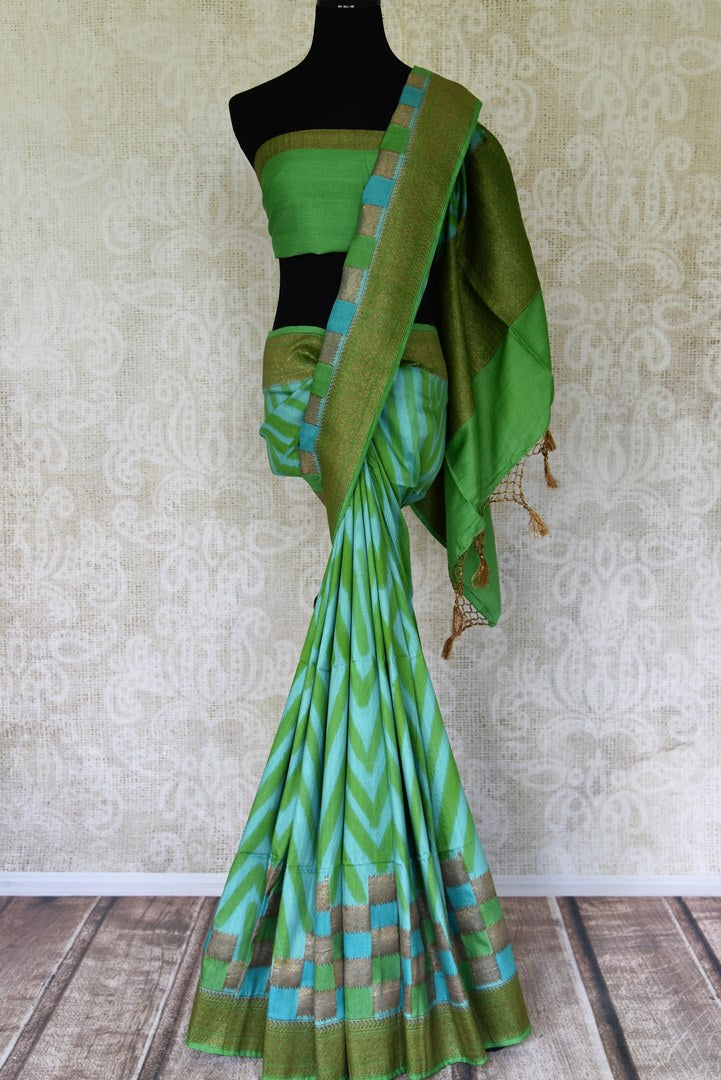 Buy green and blue chevron matka Benarasi saree with zari border online in USA from Pure Elegance. Be occasion ready always with a range of beautiful traditional handwoven saris, pure silk sarees, Banarasi saris, Kanchipuram sarees available at our Indian fashion store in USA. Grab your favorite pieces now also available at our online store.-full view