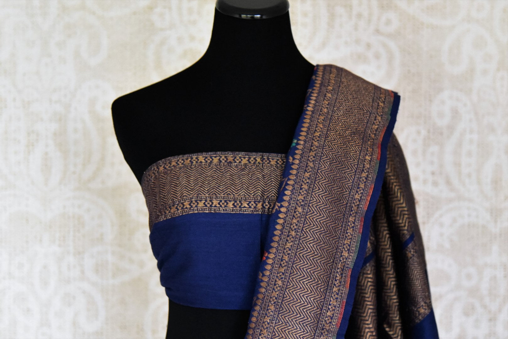 Buy dark blue muga Benarasi saree online in USA with minakari zari floral jaal. Shine bright on special occasions with traditional Indian sarees, Banarasi sarees, pure silk sarees in rich colors and designs from Pure Elegance Indian fashion store in USA.-blouse pallu