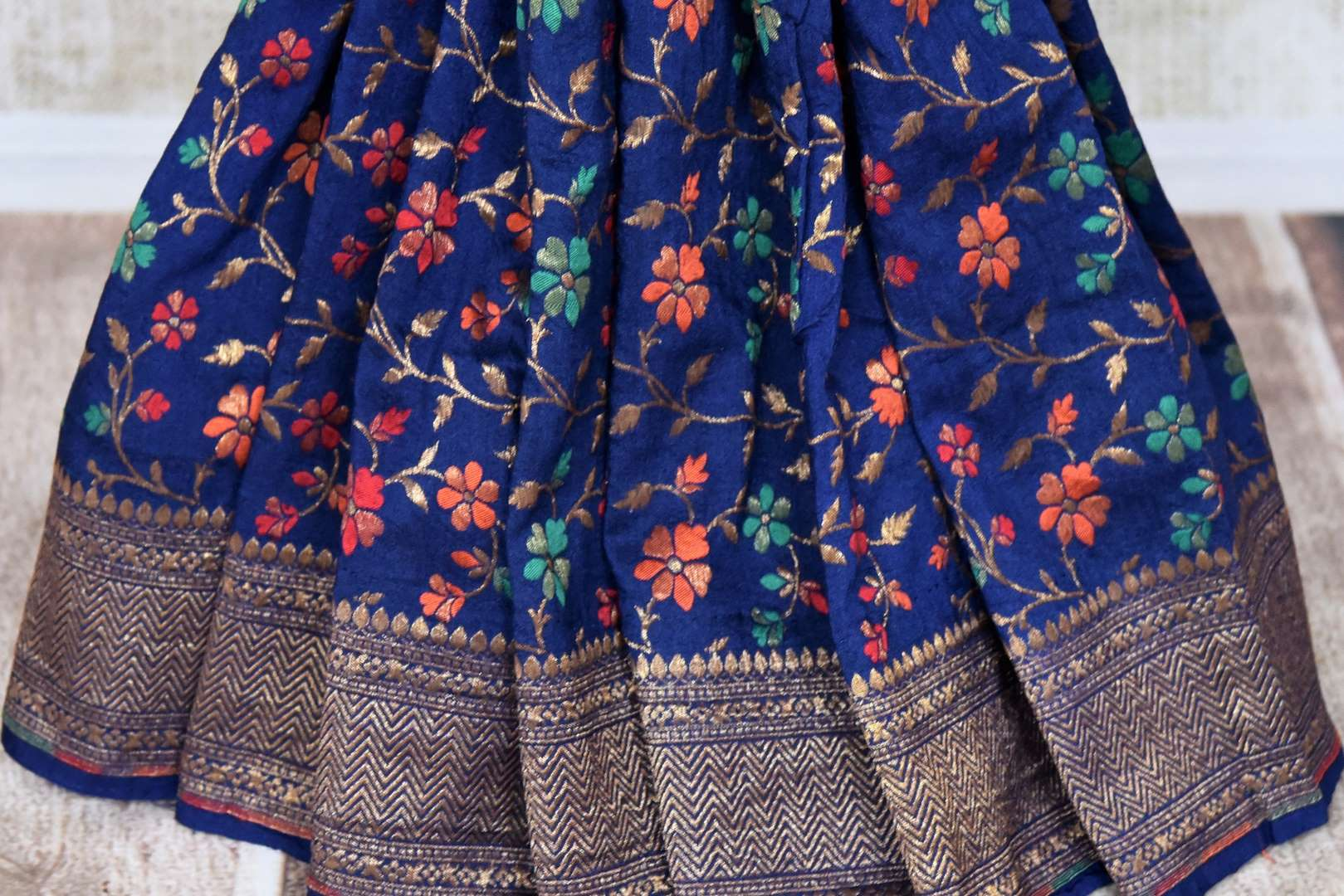 Buy dark blue muga Benarasi saree online in USA with minakari zari floral jaal. Shine bright on special occasions with traditional Indian sarees, Banarasi sarees, pure silk sarees in rich colors and designs from Pure Elegance Indian fashion store in USA.-pleats