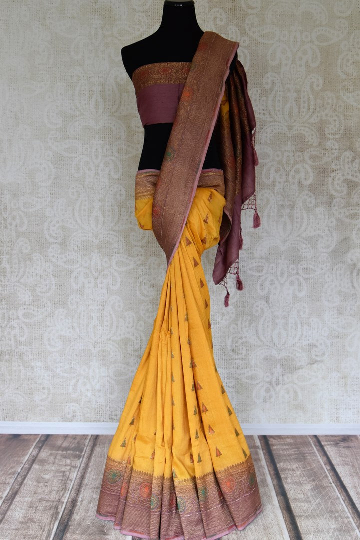 Buy yellow muga Benarasi sari online in USA with purple antique zari border. Shine bright on special occasions with traditional Indian sarees, Banarasi sarees, pure silk sarees in rich colors and designs from Pure Elegance Indian fashion store in USA.-full view