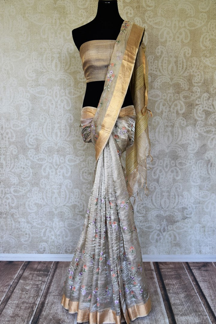 Shop silver tissue linen embroidered saree online in USA with golden border. Shine bright on special occasions with traditional Indian sarees, Banarasi sarees, pure silk sarees in rich colors and designs from Pure Elegance Indian fashion store in USA.-full view