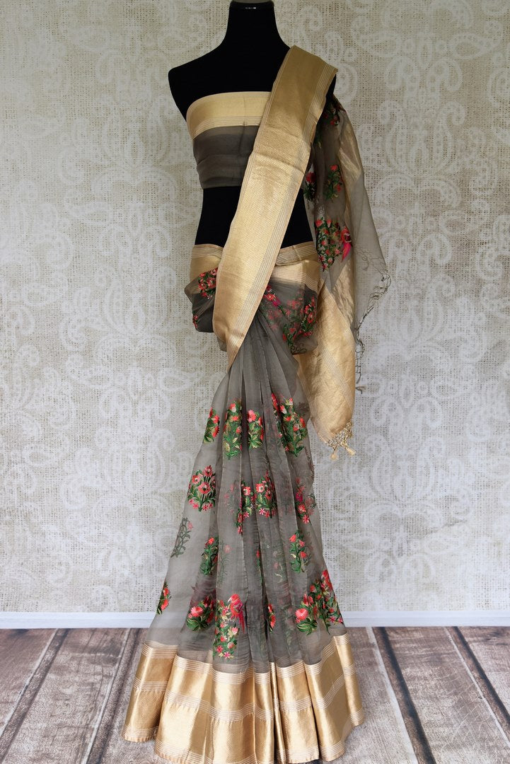 Shop dark grey color embroidered organza saree with golden border online in USA. Shop more such Indian designer sarees, embroidered sarees, pure silk sarees in USA from Pure Elegance clothing fashion store this wedding season.-full view