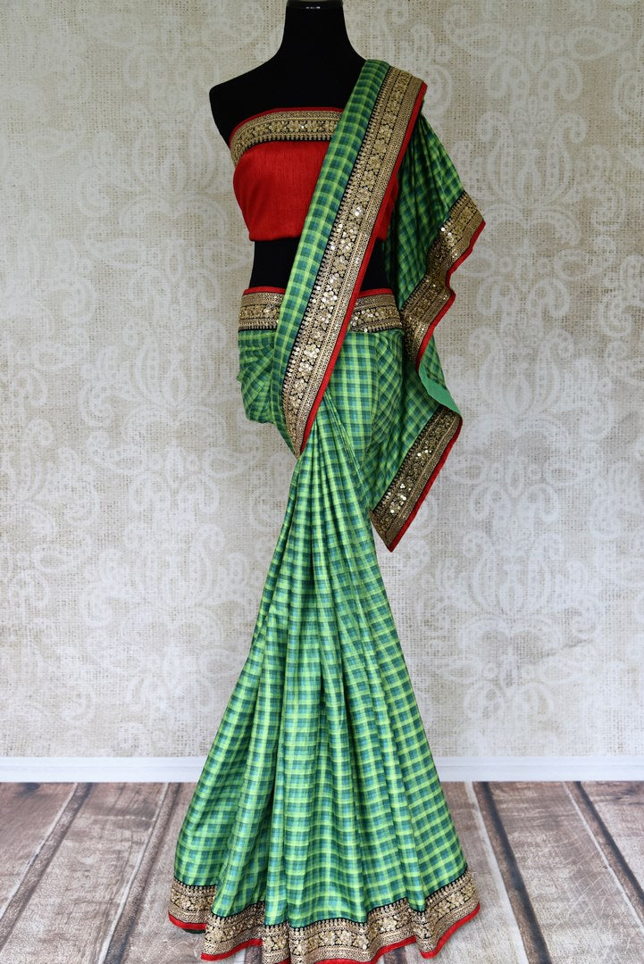 Shop green check Pashmina saree with embroidered border online in USA from Pure Elegance. Be an epitome of Indian fashion on special occasions with beautiful designer sarees, Banarasi sarees, Kanchipuram silk sarees available at our Indian fashion store in USA. -full view