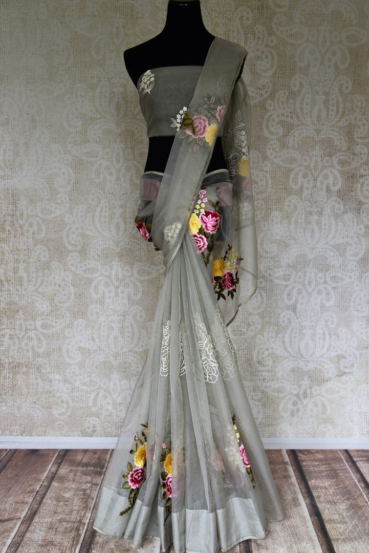 Buy grey organza sari with embroidered floral motifs online in USA from Pure Elegance. Be occasion ready always with a range of beautiful traditional handwoven saris, pure silk sarees, Banarasi saris, Kanchipuram sarees available at our Indian fashion store in USA. Grab your favorite pieces now also available at our online store.-full view