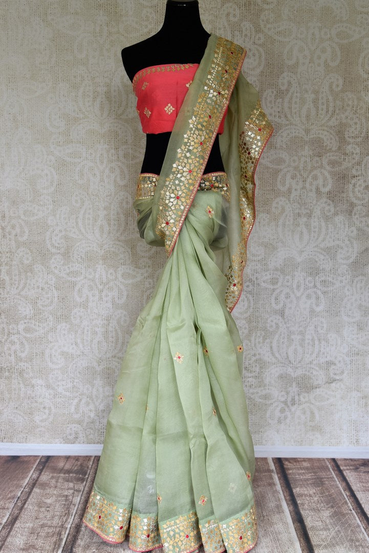 Shop pista green gota patti embroidery organza saree online in USA. Shop more such Indian designer sarees, embroidered sarees, pure silk sarees in USA from Pure Elegance clothing fashion store this wedding season.-full view