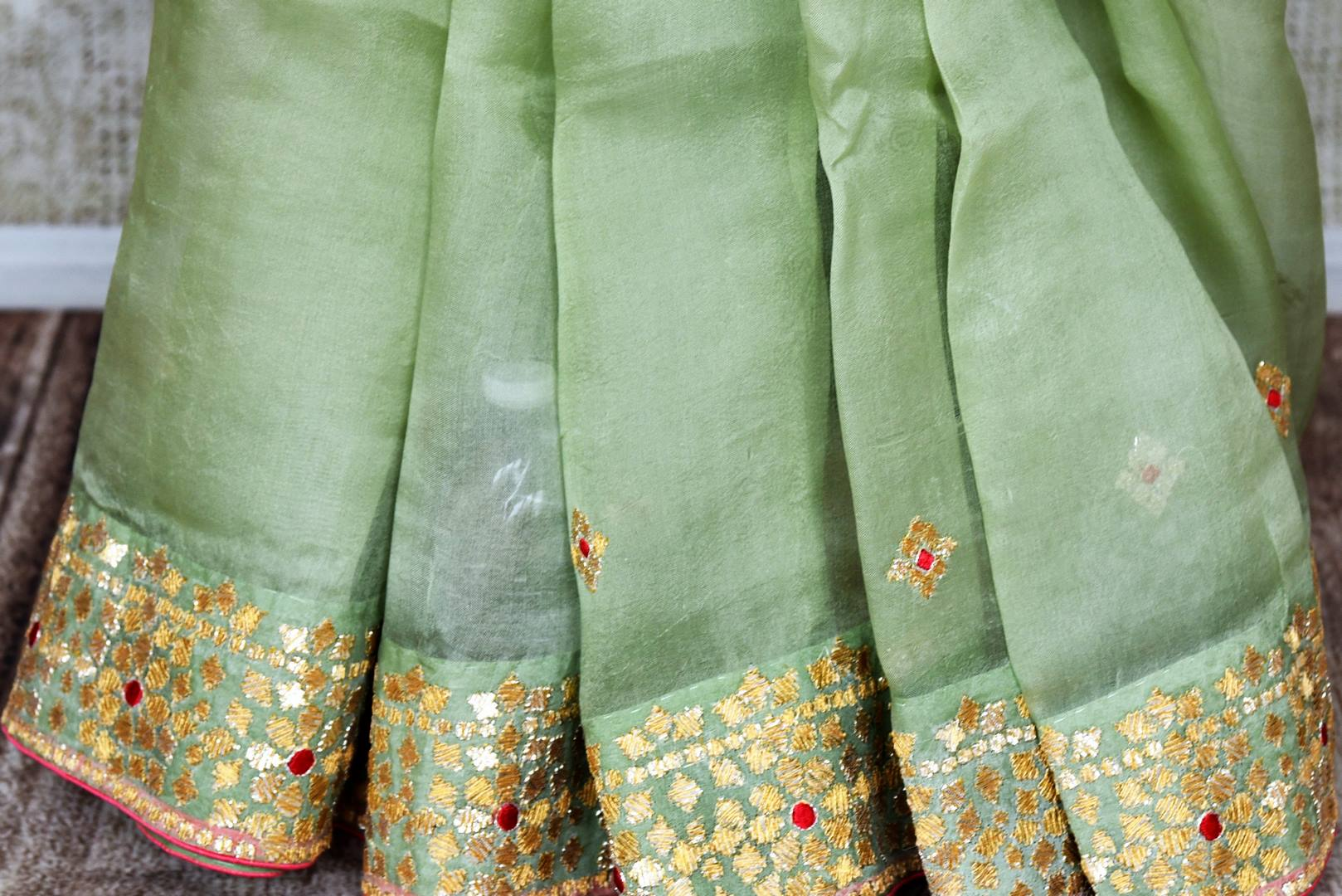 Shop pista green gota patti embroidery organza saree online in USA. Shop more such Indian designer sarees, embroidered sarees, pure silk sarees in USA from Pure Elegance clothing fashion store this wedding season.-pleats