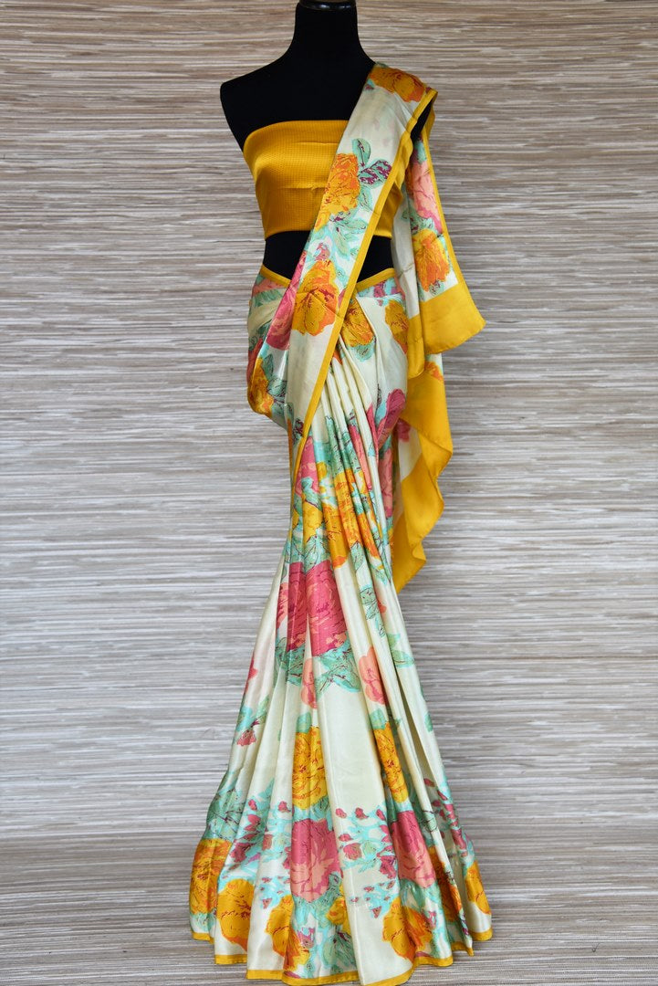 Buy powder green crepe silk sari with floral print online in USA from Pure Elegance. Be an epitome of Indian fashion with an exquisite variety of Indian handloom sarees, pure silk sarees, Bollywood sarees from our exclusive fashion store in USA.-full view