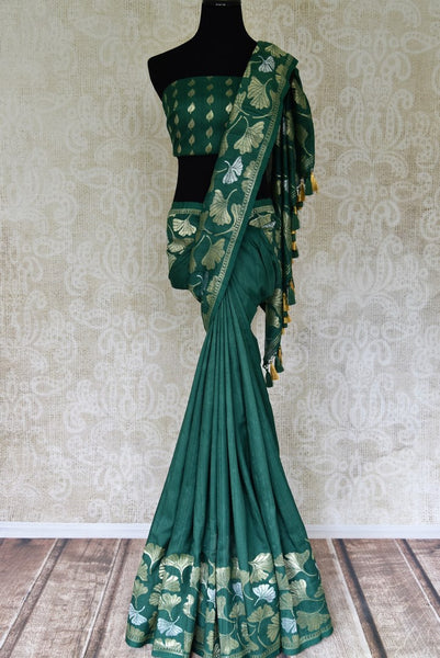 Shop sea green khaddi Benarasi saree with floral zari border online in USA from Pure Elegance. Be occasion ready always with a range of beautiful designer saris, pure silk sarees, Banarasi saris, Kanchipuram sarees available at our Indian fashion store in USA. Grab your favorite pieces now also available at our online store.-full view