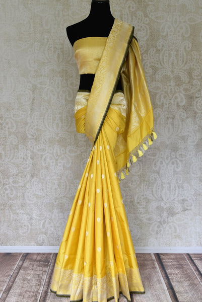 Shop yellow Banarasi silk sari with zari border online in USA. Find a splendid collection of Indian handloom sarees in USA at Pure Elegance Indian clothing store. Drape yourself in beautiful pure silk sarees, Banarasi saris, embroidered sarees on festive occasions from our online store.-full view