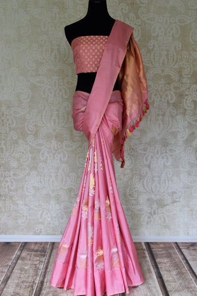 Shop pink Benarasi silk saree with zari floral buta online in USA from Pure Elegance. Be occasion ready always with a range of beautiful designer saris, pure silk sarees, Banarasi saris, Kanchipuram sarees available at our Indian fashion store in USA. Grab your favorite pieces now also available at our online store.-full view