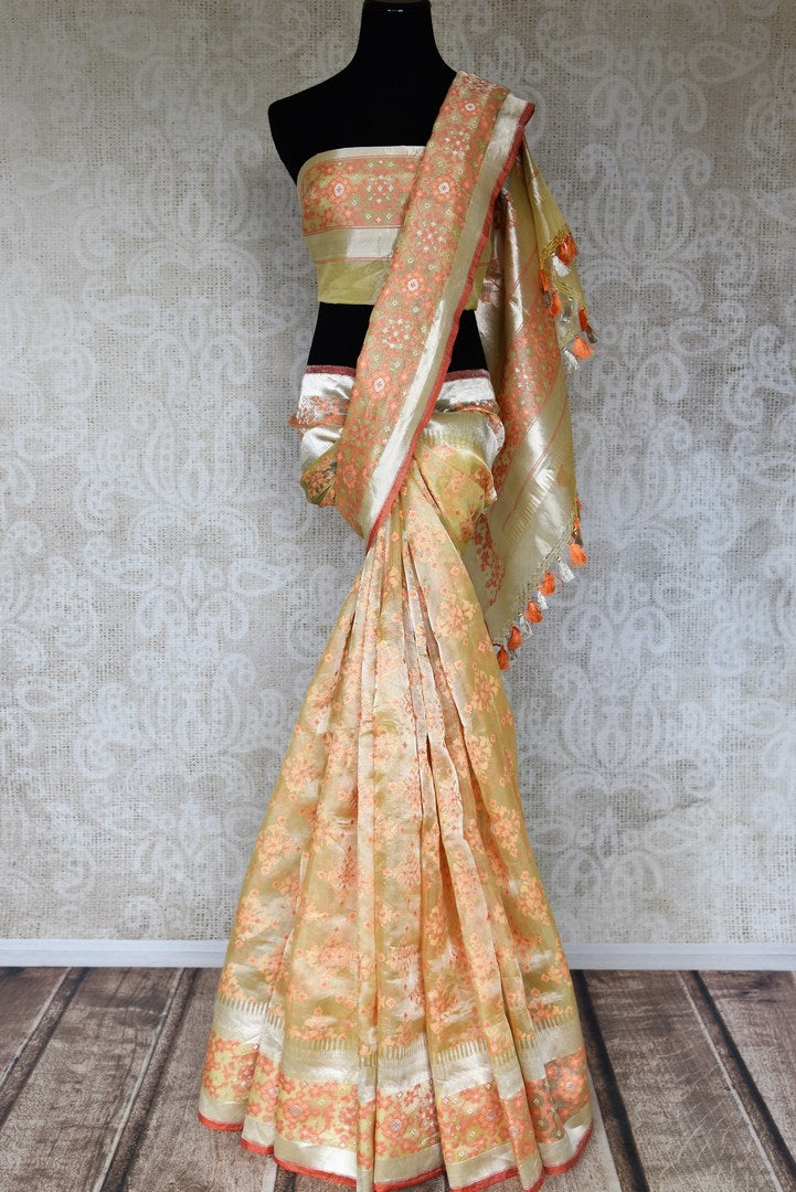 Shop beautiful cream organza Banarasi saree online in USA. Shop more such exquisite Indian saris in USA from Pure Elegance. Get floored by a range of designer sarees, pure silk sarees, Kanchipuram silk saris at our Indian fashion store in USA.-full view