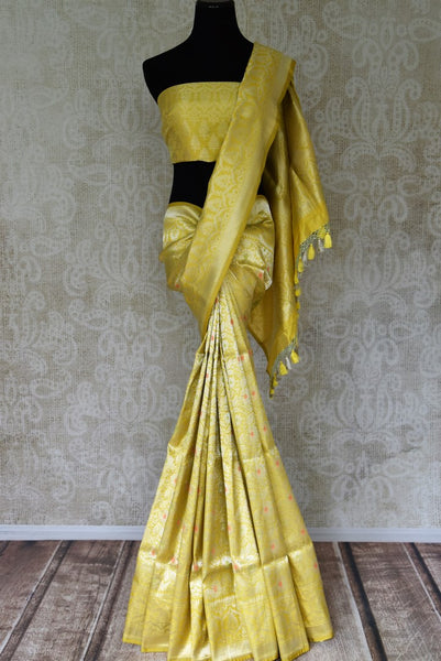 Buy yellow color Banarasi silk saree with overall floral zari jaal online in USA. Find a splendid collection of Indian handloom sarees in USA at Pure Elegance Indian clothing store. Drape yourself in beautiful pure silk sarees, Banarasi saris, embroidered sarees on festive occasions from our online store.-full view