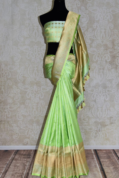 Buy green color Banarasi silk saree with gold zari border online in USA. Find a splendid collection of Indian handloom sarees in USA at Pure Elegance Indian clothing store. Drape yourself in beautiful pure silk sarees, Banarasi saris, embroidered sarees on festive occasions from our online store.-full view