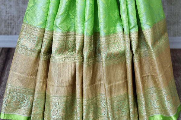 Buy green color Banarasi silk saree with gold zari border online in USA. Find a splendid collection of Indian handloom sarees in USA at Pure Elegance Indian clothing store. Drape yourself in beautiful pure silk sarees, Banarasi saris, embroidered sarees on festive occasions from our online store.-pleats
