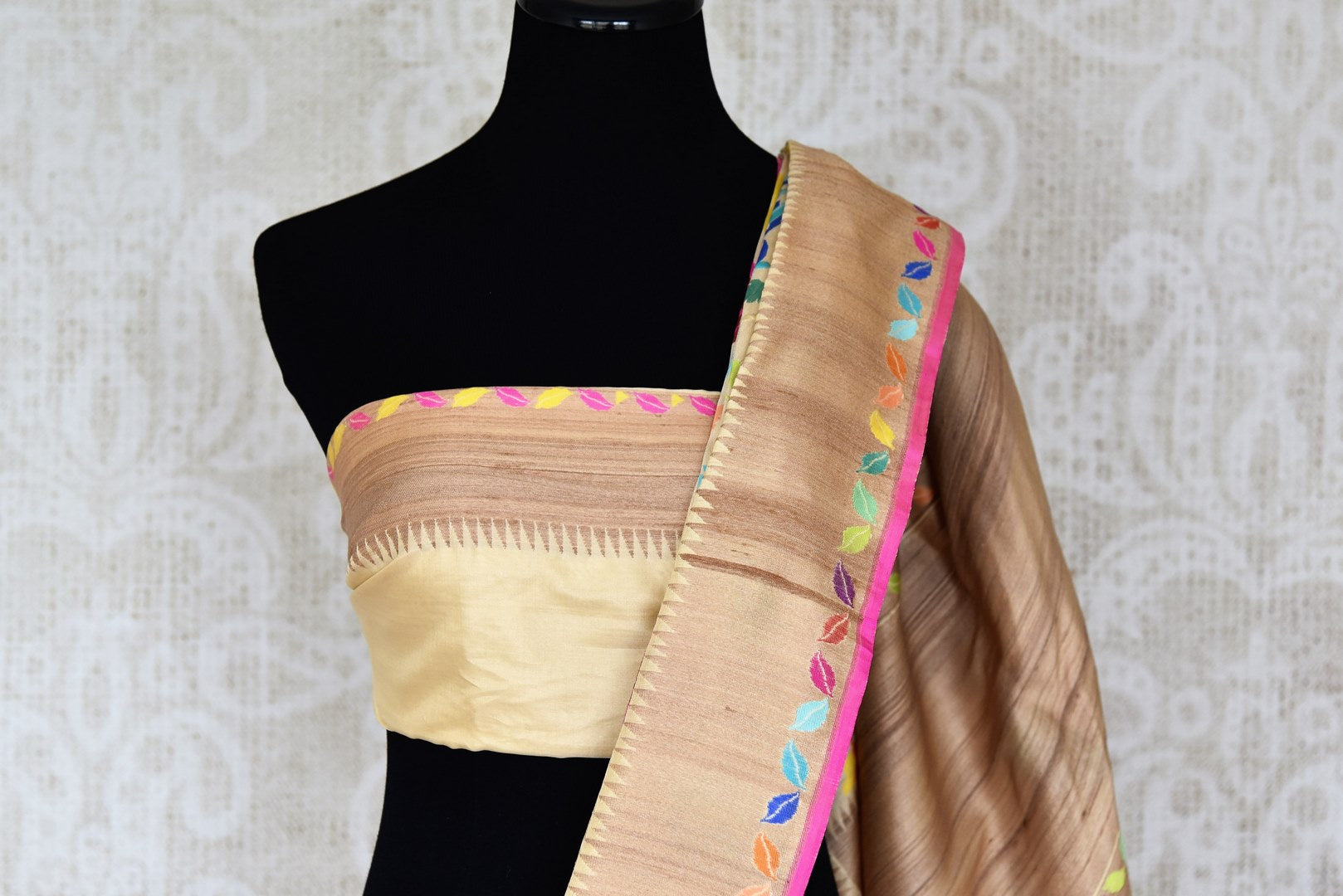 Shop beige Banarasi silk sari online in USA with bright floral jaal on border. Enhance your ethnic look with beautiful Indian designer sarees from Pure Elegance. Shop from a splendid collection of Banarasi sarees, traditional silk saris, Kanchipuram sarees from our exclusive Indian clothing store in USA.-blouse pallu