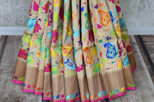 Shop beige Banarasi silk sari online in USA with bright floral jaal on border. Enhance your ethnic look with beautiful Indian designer sarees from Pure Elegance. Shop from a splendid collection of Banarasi sarees, traditional silk saris, Kanchipuram sarees from our exclusive Indian clothing store in USA.-pleats