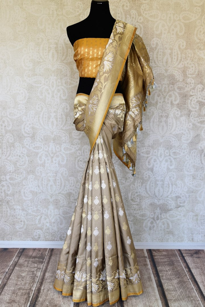 Buy beige Banarasi silk saree online in USA with silver and golden zari buta. Elevate your traditional style with exquisite Indian handloom sarees from Pure Elegance Indian clothing store in USA. Explore a range of stunning pure silk saris, Banarasi sarees, wedding sarees especially from India for women in USA.-full view