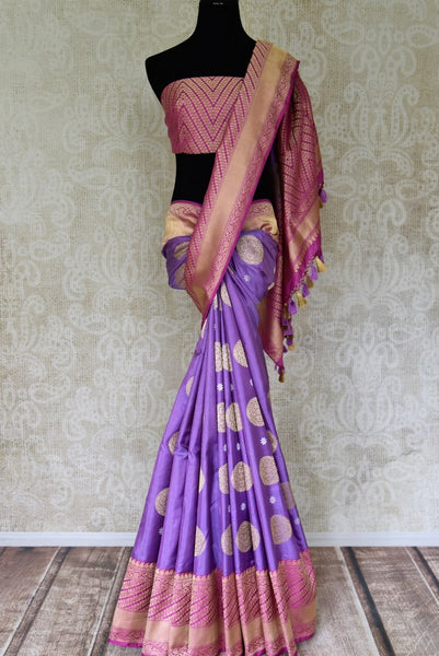 Buy bright purple Banarasi silk saree with pink zari border online in USA. Find a splendid collection of Indian handloom sarees in USA at Pure Elegance Indian clothing store. Drape yourself in beautiful pure silk sarees, Banarasi saris, embroidered sarees on festive occasions from our online store.-full view
