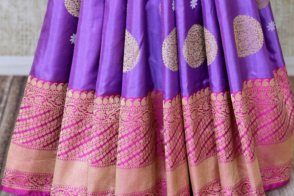 Buy bright purple Banarasi silk saree with pink zari border online in USA. Find a splendid collection of Indian handloom sarees in USA at Pure Elegance Indian clothing store. Drape yourself in beautiful pure silk sarees, Banarasi saris, embroidered sarees on festive occasions from our online store.-pleats