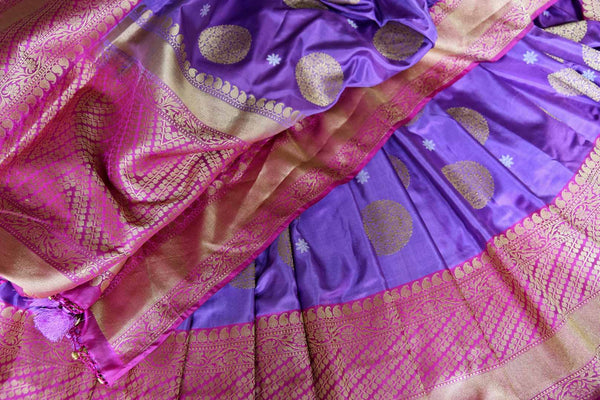 Buy bright purple Banarasi silk saree with pink zari border online in USA. Find a splendid collection of Indian handloom sarees in USA at Pure Elegance Indian clothing store. Drape yourself in beautiful pure silk sarees, Banarasi saris, embroidered sarees on festive occasions from our online store.-details