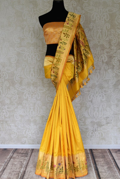 Shop yellow Banarasi silk saree with zari border online in USA and minakari floral design. Shop more such traditional Indian saris, embroidered sarees, pure silk sarees in USA from Pure Elegance clothing fashion store this wedding season.-full view